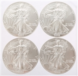 2002 UNITED STATES SILVER AMERICAN EAGLES - LOT OF 4